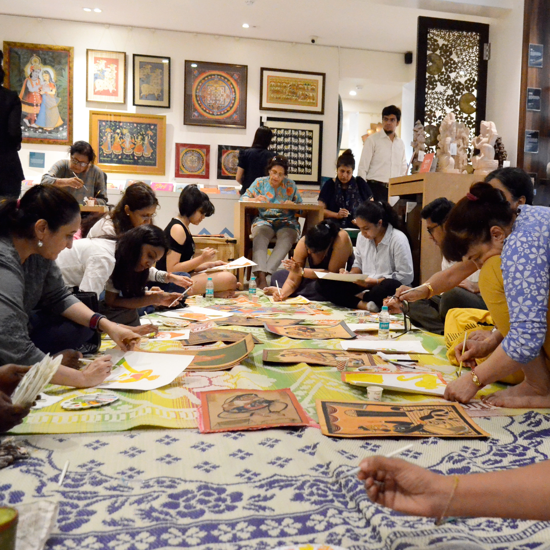 The participants working on their own Kalighat creation.