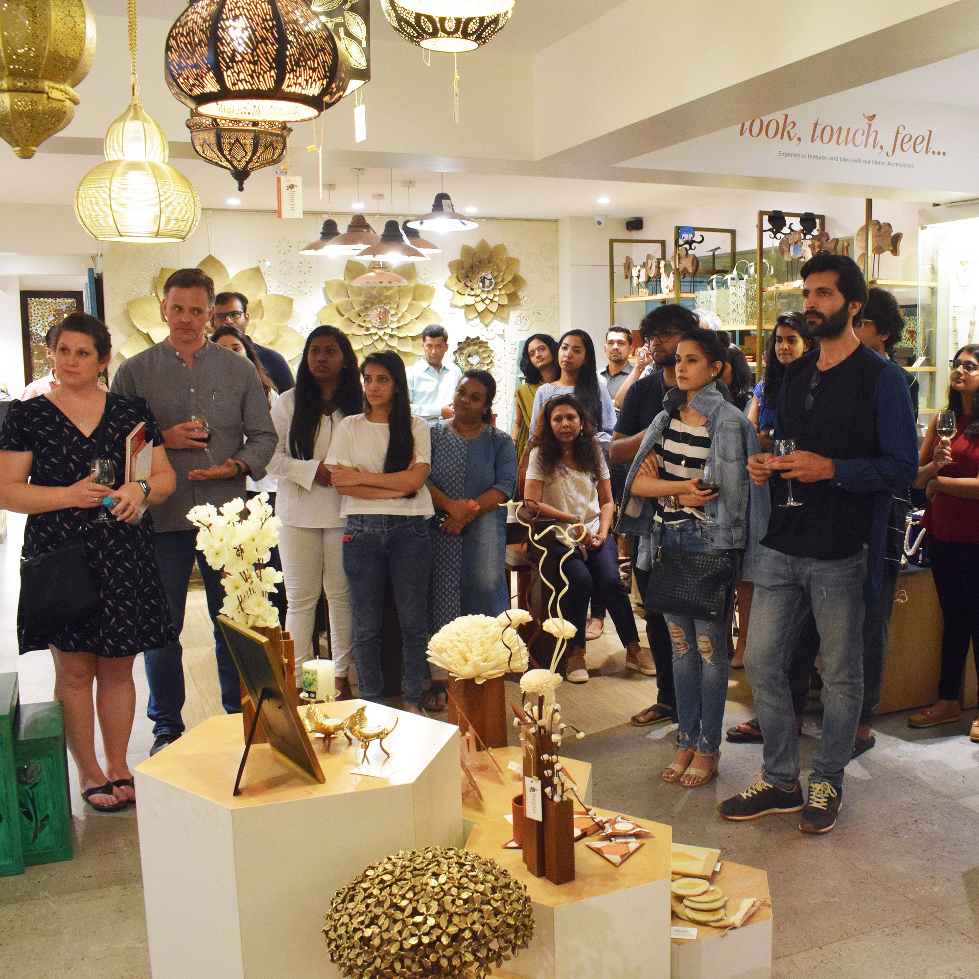 The audience in attendance watches a Baaya presentation on our design interventions towards reviving rare Indian crafts